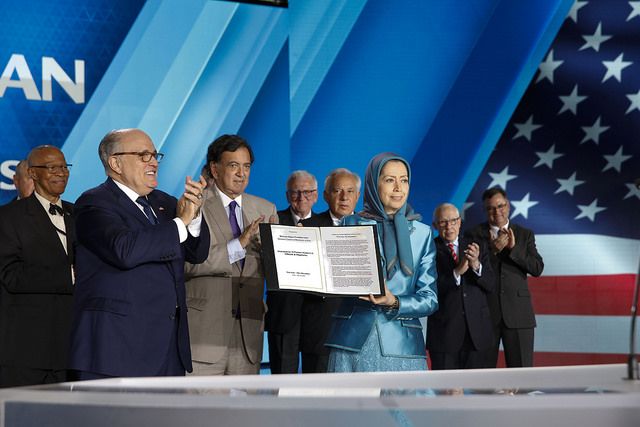 "Mayor Rudy Giuliani presents the statement signed by 33 U.S. dignitaries and former officials to Maryam Rajavi at the ""Free Iran – The Alternative"" gathering"